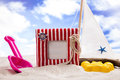 Fun on the beach with a lot of toys Royalty Free Stock Image