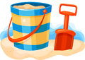 Fun at the beach vector illustration of a child s shovel and pail on sand with water in background Royalty Free Stock Photo