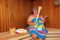 Fun big woman in sauna Royalty Free Stock Photo