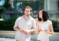 Fun with bubble blower young couple play together outdoor in street Royalty Free Stock Images