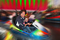 Fun in bumper cars on fair Royalty Free Stock Photo