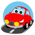 Fun car cheerful red was on an asphalt road Stock Photo