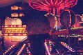 Fun carnival at night scene a street fair with glowing rides and lights Royalty Free Stock Image