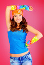 Fun colors cheerful teenager girl in bright casual clothes smiling at the camera Stock Image