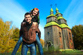 Fun couple and typical Ukrainian church Royalty Free Stock Image