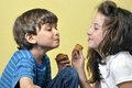 Fun with cupcakes little boy and girl have acting silly while eating Royalty Free Stock Photos