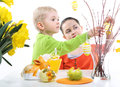 Fun easter eggs children boy and girl painting Royalty Free Stock Image