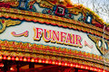 Fun fair sign traditional carousel funfair on amusement ride found at old fashioned state fairs Stock Image