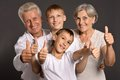 Fun family with thumbs up having a good leisure time in each other s company and showing Royalty Free Stock Photo