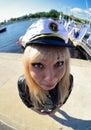 Fun fisheye view on girl looking as seamen Stock Photography