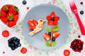 Fun food art idea for kids meal from fresh fruits and berries Royalty Free Stock Photo