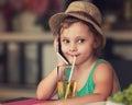 Fun happy kid girl talking on mobile phone and drinking apple ju