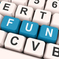 Fun keys show enjoyable exciting or pleasing on keyboard showing entertainment Royalty Free Stock Photos