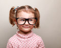 Fun kid girl in glasses looking on empty copy space Royalty Free Stock Image