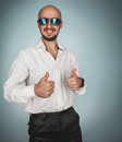Fun man in sunglasses and white shirt in studio smiling Royalty Free Stock Photo