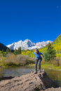 Fun at maroon bells a woman having the scenic aspen colorado in fall Royalty Free Stock Photo