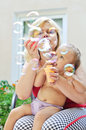 Fun of mother and baby mature with blowing soap bubbles Stock Photography