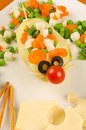 Fun mouse a kid salad with cheese decorated as a Royalty Free Stock Photography