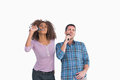 Fun pair singing at karaoke on white background Royalty Free Stock Photos