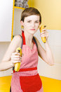 Dietician shooting banana guns in kitchen Royalty Free Stock Photo