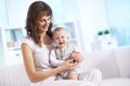 Fun portrait of happy women holding her small son while sitting at home Royalty Free Stock Photo