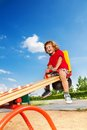 Fun on seesaw happy lauging little three years old child sitting the Stock Photos