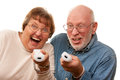 Fun Senior Couple Play Video Game with Remotes Royalty Free Stock Photo