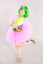 Fun shot of pretty little girl fashion beautiful in costume with green hair and tutu Stock Image