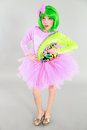 Fun shot of pretty little girl fashion beautiful in costume with green hair and tutu Stock Images