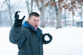 Fun snowball fight man outside on a snowy day having taking part in a Stock Image
