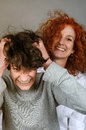 Fun son tears his hair while photo shooting with his mother Royalty Free Stock Images