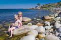 Fun on swedish beach happy kids the rocky Royalty Free Stock Images