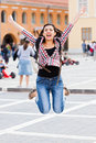Fun while traveling excited student jumping feeling an overdose of happiness Royalty Free Stock Images