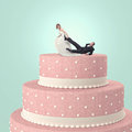 Fun at wedding funny cake with goom and bride Stock Photos