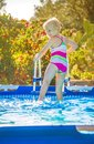 Smiling healthy girl in colorful swimsuit in swimming pool Royalty Free Stock Photo