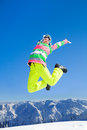 Fun winter holiday young woman enjoy rest on ski in mountains Royalty Free Stock Images