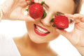 Fun woman with strawberry on the white background this image has attached release Stock Image