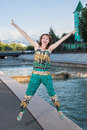 Fun young woman jumping on embankment Royalty Free Stock Images