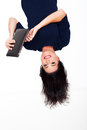 Fun young woman using tablet computer upside down Stock Image