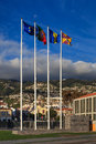 Funchal flagpoles a collection of flags on the waterfront the flags include those of the european union portugal madeira and Royalty Free Stock Photos