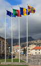 Funchal flagpoles a collection of flags on the waterfront the flags include those of the european union portugal madeira and Royalty Free Stock Photo