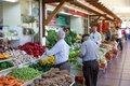 FUNCHAL, PORTUGAL - MAY 02: Unknown people visiting the vegetable market of the famous Mercado dos Lavradores on May 02, 2014 in F Royalty Free Stock Photo