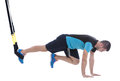 Functional exercises athletic trainer on loops for training isolated on white background Royalty Free Stock Photography