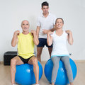 Functional training two elder persons during on medicine balls with coach Royalty Free Stock Photos