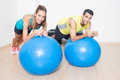 Functional training two persons during on medicine balls Royalty Free Stock Image