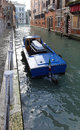 Funeral boat for with casket in venice canal Stock Photo