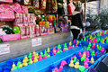 Funfair game stall france colorful plastic ducks floating on water at a at a Stock Images