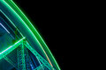 Funfair night neon lights of giant wheel at during Royalty Free Stock Photos