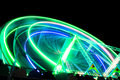 Funfair night neon lights of giant wheel at during Stock Images