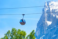 Funicular on ropeway near alps going the the background of mountain in summer Stock Image